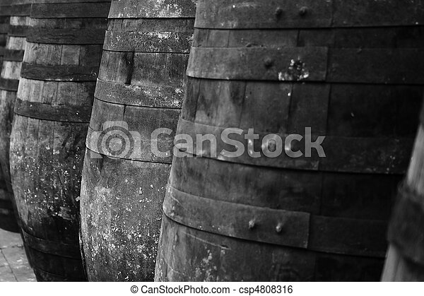 Old barrels stacked in rows - csp4808316