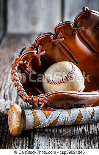 Old baseball bat and glove with ball - csp39021846