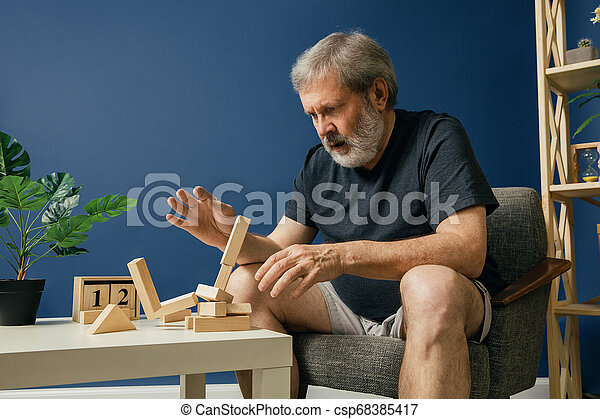 Old bearded man with alzheimer desease - csp68385417