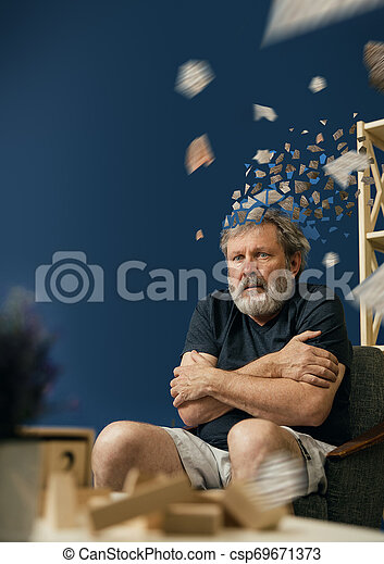 Old bearded man with alzheimer desease - csp69671373