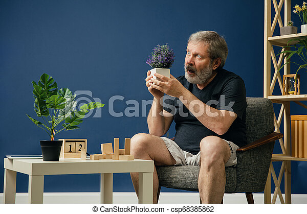 Old bearded man with alzheimer desease - csp68385862