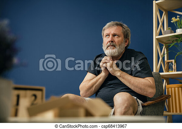 Old bearded man with alzheimer desease - csp68413967