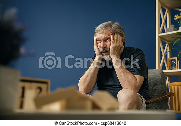Old bearded man with alzheimer desease - csp68413842