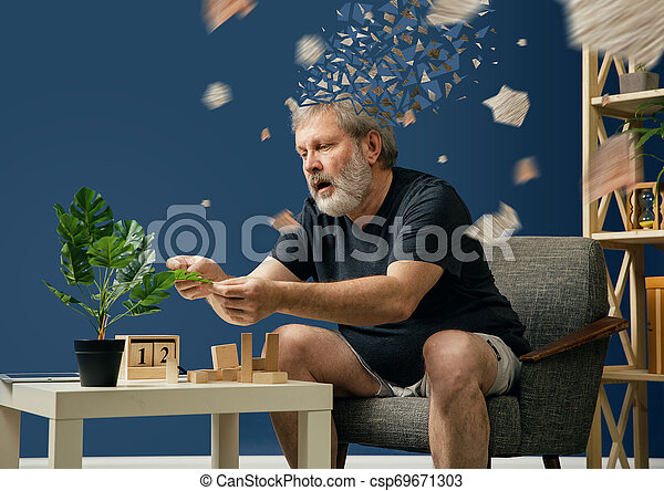 Old bearded man with alzheimer desease - csp69671303