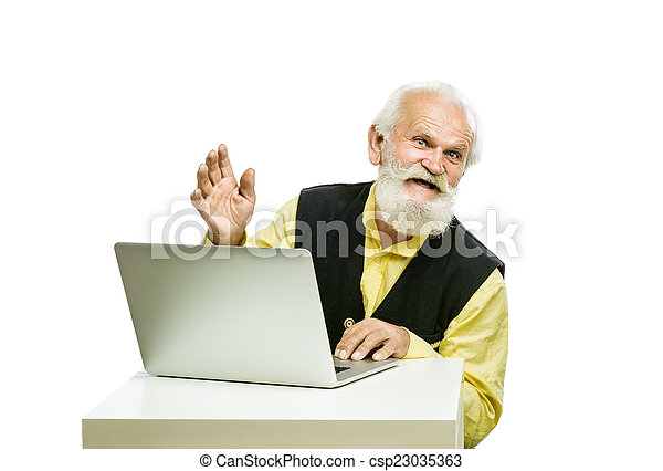 Old bearded man with laptop isolated - csp23035363