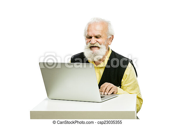 Old bearded man with laptop isolated - csp23035355