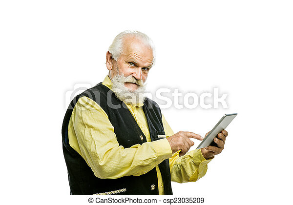 Old bearded man with tablet isolated - csp23035209