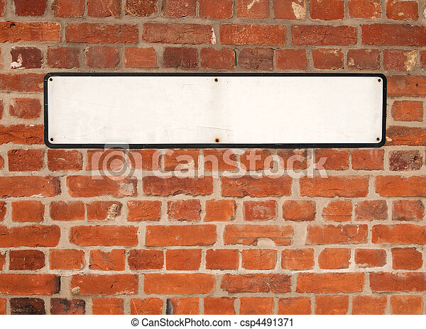 Old blank white British street sign on a red brick wall. - csp4491371
