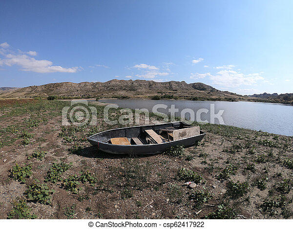 Old boat by the lake in Georgia - csp62417922