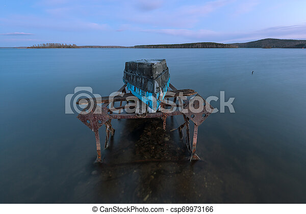 old boat on a rusty iron frame - csp69973166