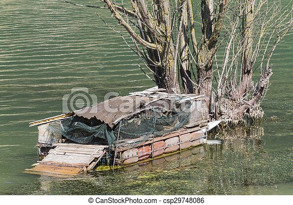 old boat on lake - csp29748086