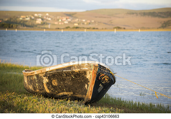 Old boat on river bank - csp43106663