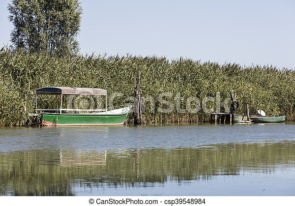 old boat on river - csp39548984