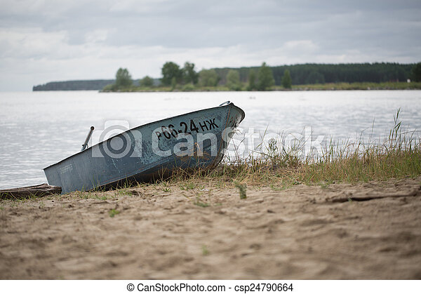 Old boat on the river - csp24790664