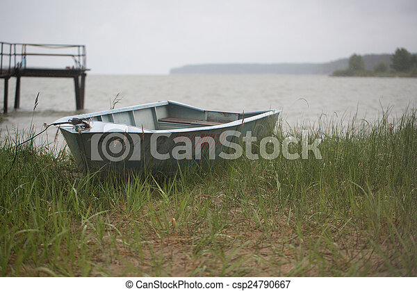 Old boat on the river - csp24790667