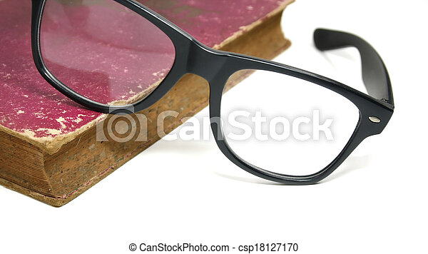 Old book and glasses on a white background - csp18127170