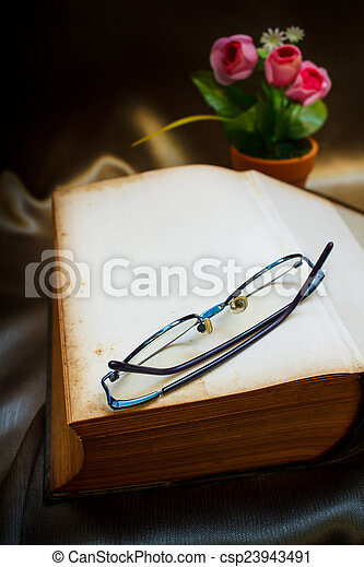 Old book and glasses. - csp23943491