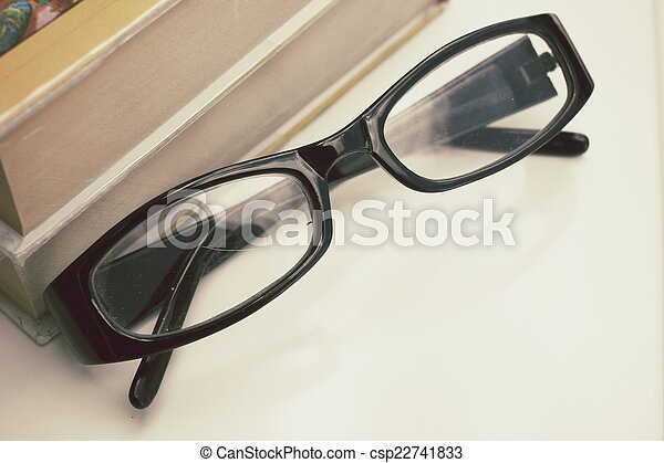 old book and glasses - csp22741833