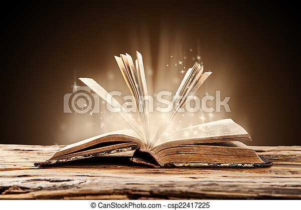 Old book on wooden table - csp22417225