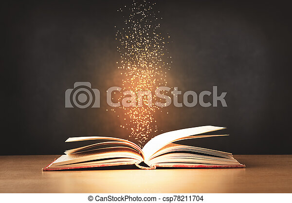 Old Book Opened on Desk with Sparkling stars Rising Upwards - csp78211704
