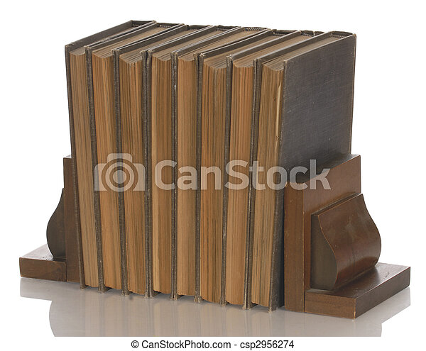 old books held up with wooden bookends with reflection on white background - csp2956274