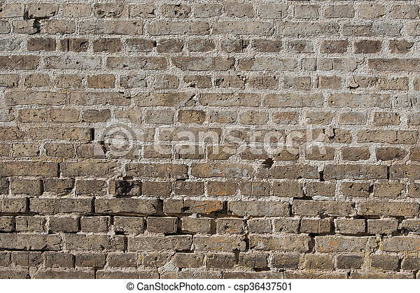 Old brick wall with worn stones - csp36437501