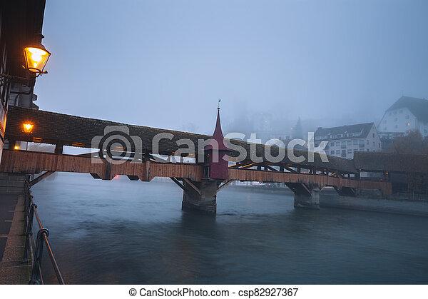 Old bridge in Lucerne - csp82927367
