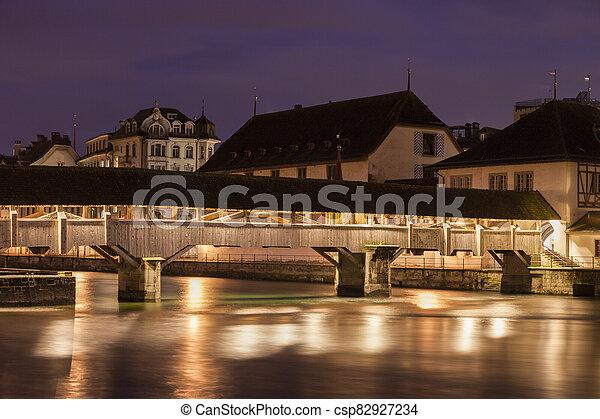 Old bridge in Lucerne - csp82927234