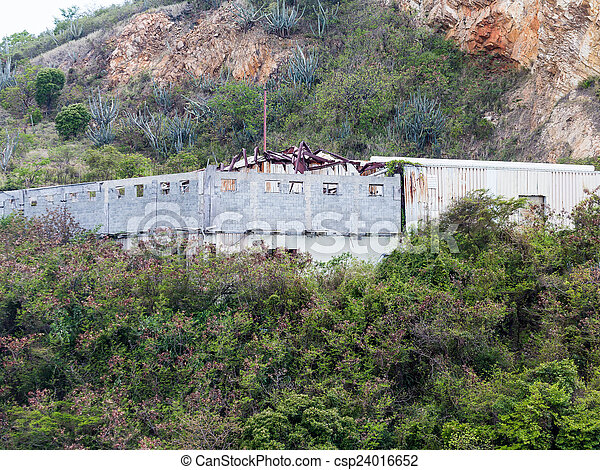 Old Building on Tropical Hillside with Hurricane Damage - csp24016652