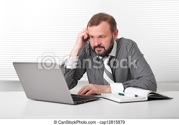 Old Business man with Laptop - csp12815879