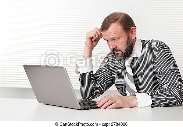 Old Business man with Laptop - csp12784026