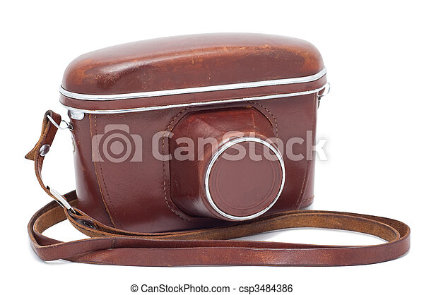 Old camera in a cover isolated on a white background shadow below. - csp3484386