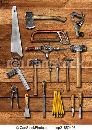 Old carpenter hand tools on wood - csp21852496