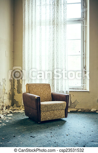 old chair by the window - csp23531532