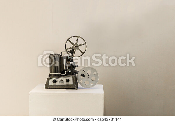 Old Cinema Projector On White Background