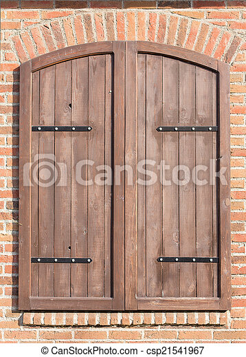 Old closed window wooden shutters - csp21541967