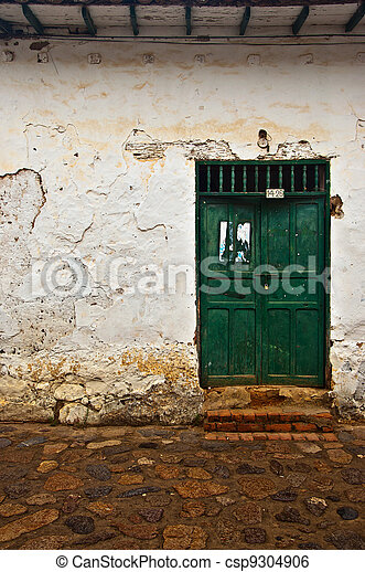 Old Colonial Wall with a Green Door - csp9304906