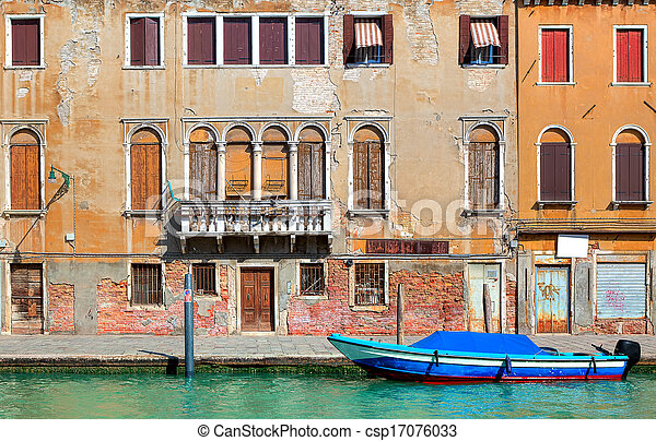 Old colorful house along narrow canal in Venice. - csp17076033