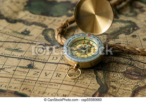 Old compass on vintage map with rope - csp55580660
