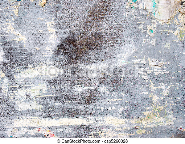 Old concrete wall with peaces of wallpaper - csp5260028