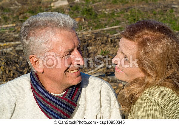 old couple sitting at ground - csp10950345