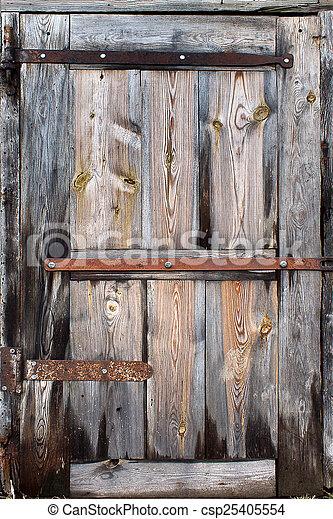 old door made of wooden boards closeup - csp25405554