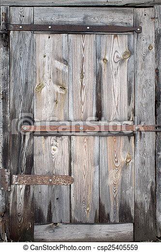 old door made of wooden boards closeup - csp25405559