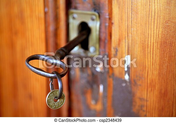 Old door woth rusted key, pesetas coin - csp2348439