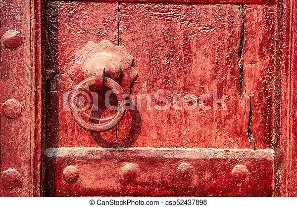 Old doorknob on vintage red door in india. Ancient door... stock ...