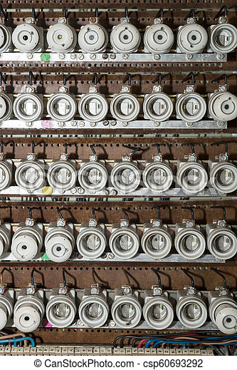 Old electrical fuse box with porcelain fuses. Old electrical fuse box with  white porcelain fuses.Can Stock Photo