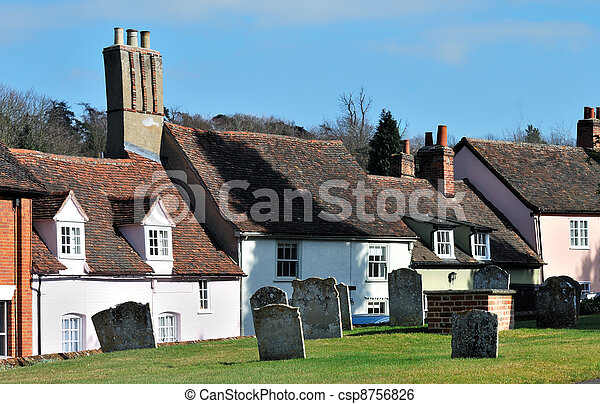 Old english village graveyard and cottages - csp8756826