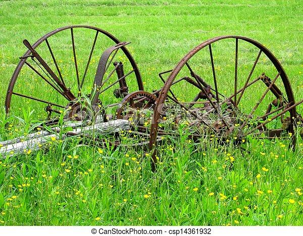 Old Farm Equipment Worn Ancient Farm Equipment In A Green