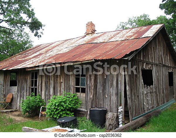 Closeup Of Old Farm House With Red Tin Roof