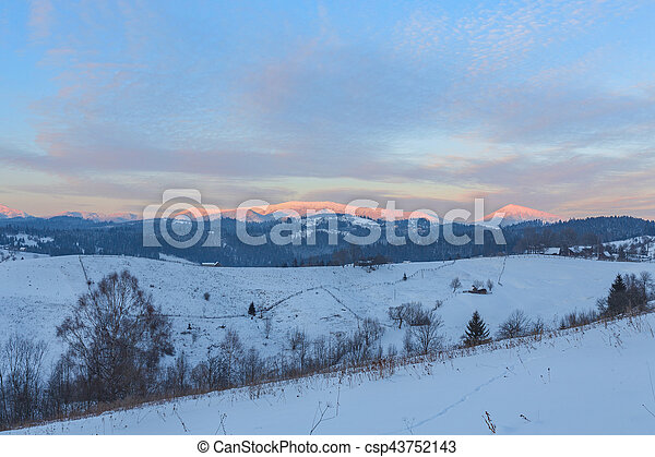 Old farm in mountains. Sunny winter morning. Retro style. - csp43752143